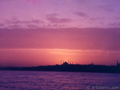 A sunset view of Sarayburnu coast and Sultan Ahmet Mosque (Blue Mosque) from the Bosphorus in Istanbul city of Turkey. The picture was taken by Artislamic.com in 1985 with an old model camera.