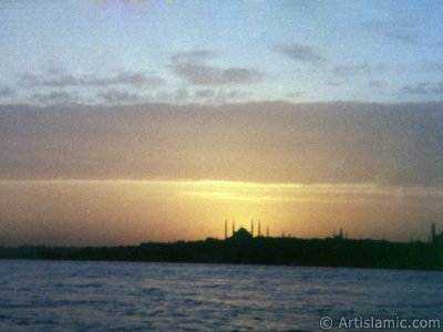 A sunset view of Sarayburnu coast and Sultan Ahmet Mosque (Blue Mosque) from the Bosphorus in Istanbul city of Turkey.