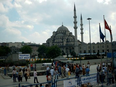 View of Yeni Cami (Mosque) and Eminonu square from the shore of Eminonu in Istanbul city of Turkey.