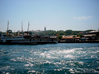 View of Eminonu coast, ships and Topkapi Palace from the sea in Istanbul city of Turkey.