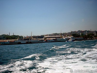 View of Eminonu coast, ships and Ayasofya Mosque (Hagia Sophia) from the sea in Istanbul city of Turkey.