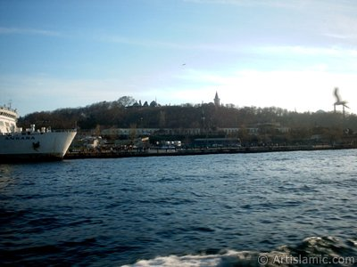 View of Sarayburnu coast, ships and Topkapi Palace from the sea in Istanbul city of Turkey.