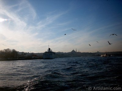 View of Eminonu coast, Suleymaniye Mosque and Fatih Mosque from the Bosphorus in Istanbul city of Turkey.