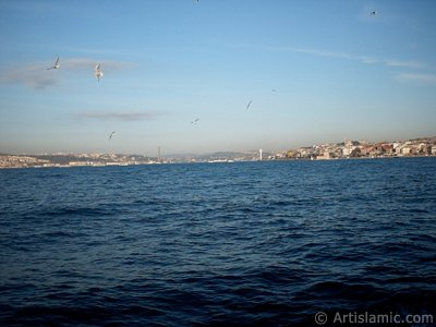 View of Bosphorus Bridge, Uskudar coast and Kiz Kulesi (Maiden`s Tower) from the Bosphorus in Istanbul city of Turkey.