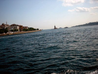 View of Uskudar coast, Kiz Kulesi (Maiden`s Tower) and Sarayburnu coast from the Bosphorus in Istanbul city of Turkey. (The picture was taken by Artislamic.com in 2004.)