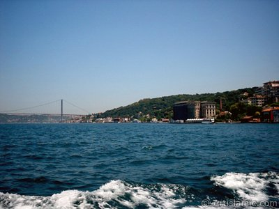 View of Uskudar coast and Bosphorus Bridge from the Bosphorus in Istanbul city of Turkey.