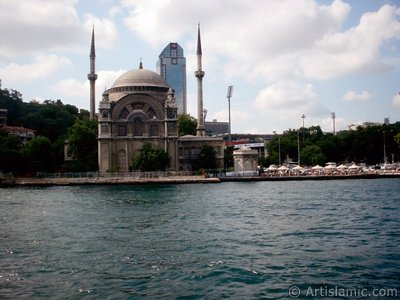 View of Dolmabahce coast and Valide Sultan Mosque from the Bosphorus in Istanbul city of Turkey.