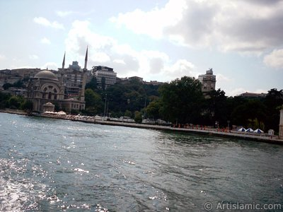 View of Dolmabahce coast, Valide Sultan Mosque and clock tower from the Bosphorus in Istanbul city of Turkey. (The picture was taken by Artislamic.com in 2004.)