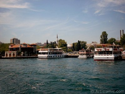 View of Besiktas jetty and Sinan Pasha Mosque its behind from the Bosphorus in Istanbul city of Turkey. (The picture was taken by Artislamic.com in 2004.)