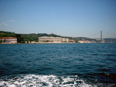 View of the Ciragan Palace and the Bosphorus Bridge from the Bosphorus in Istanbul city of Turkey.