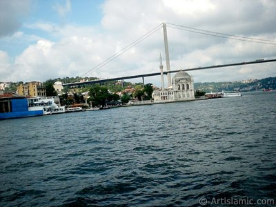 View of Ortakoy coast, Ortakoy Mosque and Bosphorus Bridge from the Bosphorus in Istanbul city of Turkey.