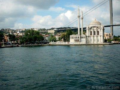 View of Ortakoy coast, Ortakoy Mosque and Bosphorus Bridge from the Bosphorus in Istanbul city of Turkey. (The picture was taken by Artislamic.com in 2004.)