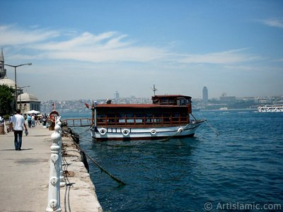 View of the shore, a fisher boat and Semsi Pasha Mosque in Uskudar district of Istanbul city of Turkey.