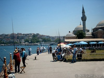 View of fishing people and Semsi Pasha Mosque made by Architect Sinan in Uskudar shore of Istanbul city of Turkey. (The picture was taken by Artislamic.com in 2004.)
