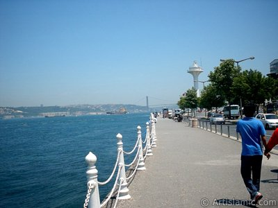 View of the shore and on the horizon Bosphorus Bridge from Uskudar district of Istanbul city of Turkey.
