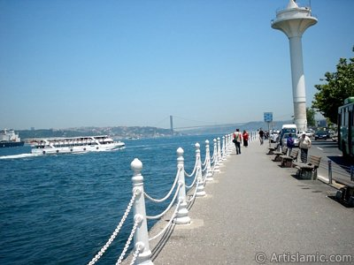 View of the shore and on the horizon Bosphorus Bridge from Uskudar district of Istanbul city of Turkey. (The picture was taken by Artislamic.com in 2004.)