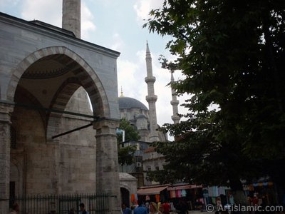 View of Nuruosmaniye Mosque from Mahmut Pasha Mosque`s outside court in Beyazit district in Istanbul city of Turkey.