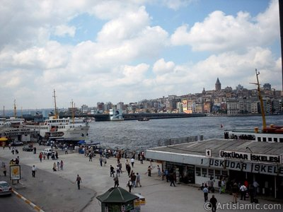 View of jetties, square, Galata Bridge and historical Galata Tower from an overpass at Eminonu district in Istanbul city of Turkey.