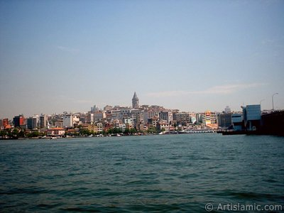 View of Karakoy coast and Galata Bridge from the shore of Eminonu in Istanbul city of Turkey.