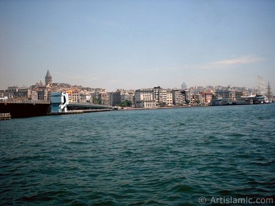 View of Karakoy coast, Galata Bridge and Galata Tower from the shore of Eminonu in Istanbul city of Turkey.