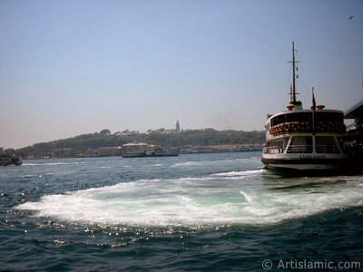 View of Eminonu coast, the ship and Topkapi Palace from the shore of Karakoy in Istanbul city of Turkey.