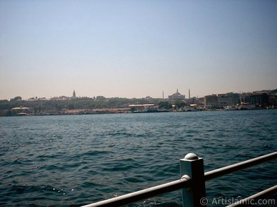 View of Eminonu coast, Ayasofya Mosque (Hagia Sophia) and Topkapi Palace from the shore of Karakoy in Istanbul city of Turkey.