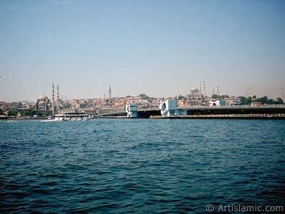 View of (from left) Yeni Cami (Mosque), (at far behind) Beyazit Mosque, Beyazit Tower, Galata Brigde and Suleymaniye Mosque from the shore of Karakoy in Istanbul city of Turkey.