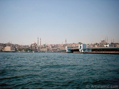 View of Eminonu coast, (from left) Sultan Ahmet Mosque (Blue Mosque), Yeni Cami (Mosque), (at far behind) Beyazit Mosque, Beyazit Tower, Galata Brigde and Suleymaniye Mosque from the shore of Karakoy in Istanbul city of Turkey.