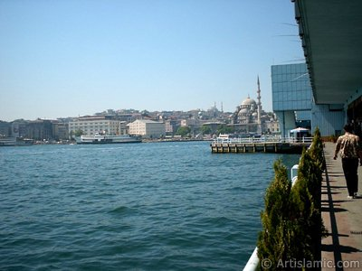View of Eminonu coast, Sultan Ahmet Mosque (Blue Mosque) and Yeni Cami (Mosque) from under the Galata Bridge in Istanbul city of Turkey.
