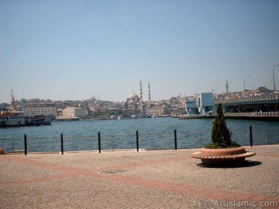 View of Eminonu coast, (from left) Sultan Ahmet Mosque (Blue Mosque), Yeni Cami (Mosque), (at far behind) Beyazit Mosque, Beyazit Tower and Galata Brigde from the shore of Karakoy in Istanbul city of Turkey. (The picture was taken by Artislamic.com in 2004.)
