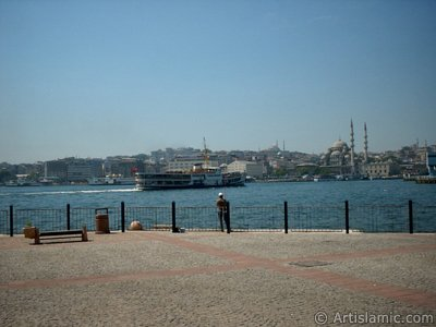 View of fishing man, Eminonu coast, Sultan Ahmet Mosque (Blue Mosque) and Yeni Cami (Mosque) from the shore of Karakoy in Istanbul city of Turkey.