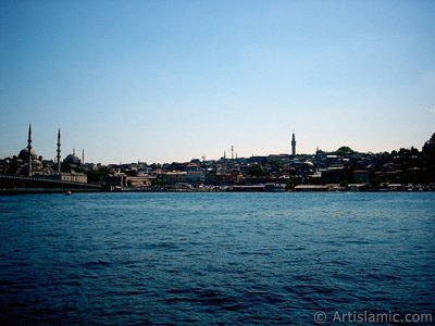 View of Eminonu coast, (from left) Galata Bridge, Yeni Cami (Mosque), Sultan Ahmet Mosque (Blue Mosque), (below) Egyptian Bazaar (Spice Market) and Beyazit Tower from the shore of Karakoy-Persembe Pazari in Istanbul city of Turkey.