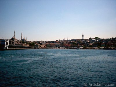 View of Eminonu coast, (from left) Galata Bridge, Yeni Cami (Mosque), Sultan Ahmet Mosque (Blue Mosque), (below) Egyptian Bazaar (Spice Market) and Beyazit Tower from the shore of Karakoy-Persembe Pazari in Istanbul city of Turkey. (The picture was taken by Artislamic.com in 2004.)