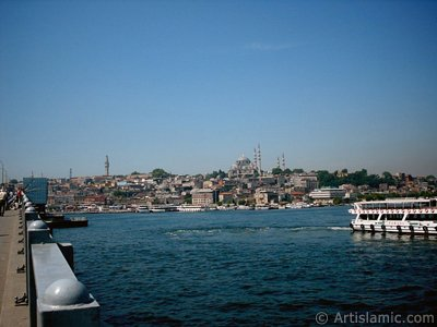 View of coast, (from left) Beyazit Tower, below Rustem Pasha Mosque and above it Suleymaniye Mosque from Galata Bridge located in Istanbul city of Turkey.
