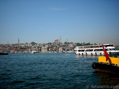 View of Eminonu coast, (from left) Beyazit Tower, (below) Rustem Pasha Mosque and (above) Suleymaniye Mosque from the shore of Karakoy-Persembe Pazari in Istanbul city of Turkey.