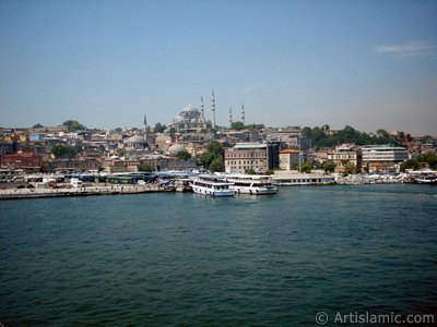 View of coast, (from left) below Rustem Pasha Mosque and above it Suleymaniye Mosque from Galata Bridge located in Istanbul city of Turkey.