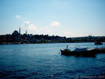 View of Eminonu coast, Suleymaniye Mosque (on the left) and (on the horizon) Fatih Mosque from the shore of Karakoy-Persembe Pazari in Istanbul city of Turkey.