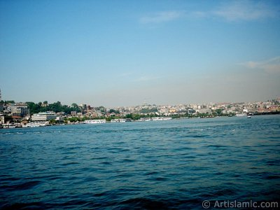View of Eminonu-Sarachane coast, on the horizon in the middle Fatih Mosque and on the right Yavuz Sultan Selim Mosque from Galata Bridge located in Istanbul city of Turkey.