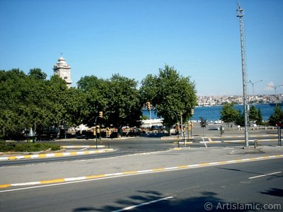 View of Dolmabahce coast and clock tower in Dolmabahce district in Istanbul city of Turkey.