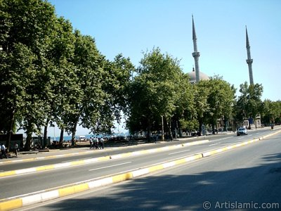 View of Dolmabahce coast and Valide Sultan Mosque in Dolmabahce district in Istanbul city of Turkey.