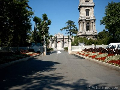 View of Dolmabahce Palace`s entrance and clock tower located in Dolmabahce district in Istanbul city of Turkey.
