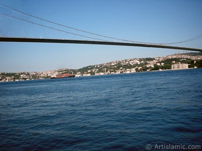 View of Bosphorus Bridge and Beylerbeyi coast from a park at Ortakoy shore in Istanbul city of Turkey.