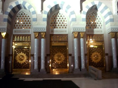 Some of the entrance doors of the Prophet Muhammad`s (saaw) Mosque (Masjed an-Nabawe) in Madina city of Saudi Arabia. (The picture was taken by Mr. Mustafa one of the visitors of Artislamic.com in 2003 Ramadan.)