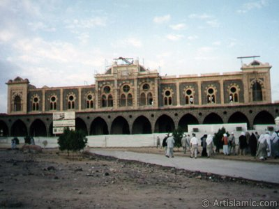 View of the Ottoman made historical Hijaz Railway`s Station in Madina city of Saudi Arabia and the Turkish pilgrims visiting this building. (The picture was taken by Mr. Mustafa one of the visitors of Artislamic.com in 2003 Hajj season.)